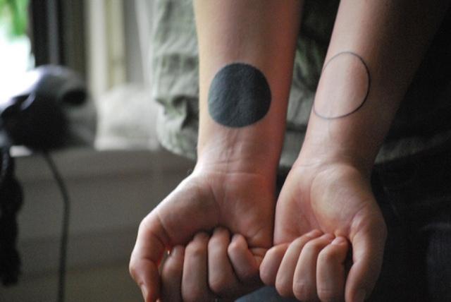 Original tattoos on the wrists