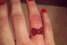 Red tattoo on the finger
