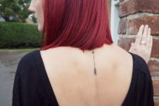 Small arrow tattoo on the back
