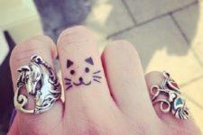 finger woman's cat tattoo