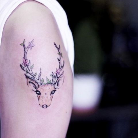 Small floral deer tattoo on the hand
