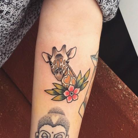 Small giraffe tattoo