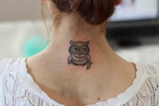 Small owl tattoo on the back