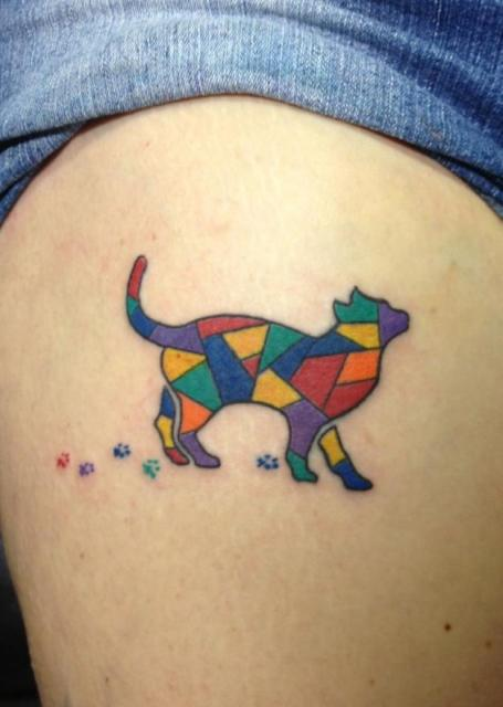 Stained glass cat tattoo