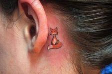 Tiny fox behind the ear