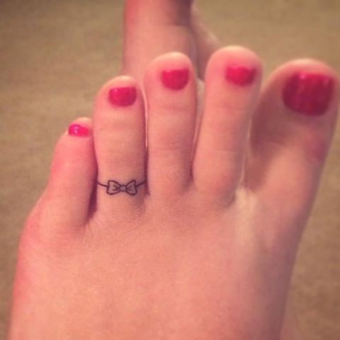 Tiny tattoo on the toe