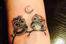 Two owls tattoo on the wrist