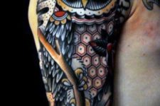 Unique colored owl tattoo