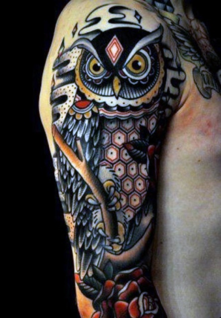 Unique colored owl tattoo
