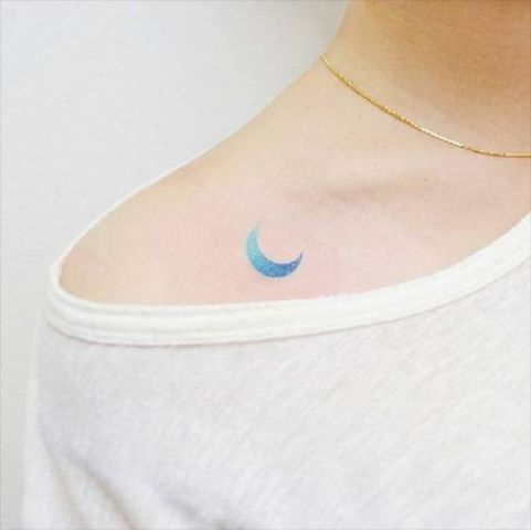 Watercolor moon tattoo on the shoulder