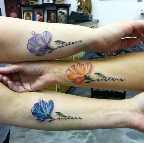 Wonderful blue, orange and lilac floral tattoos