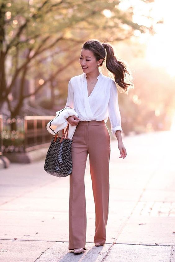a white shirt, salmon pink pants and blush heels