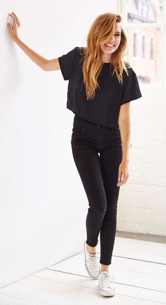 black jeans, a black crop t-shirt and white Converse