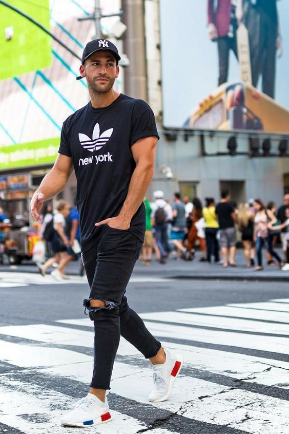 sporty look with black ripped jeans, a black tee and white trainers