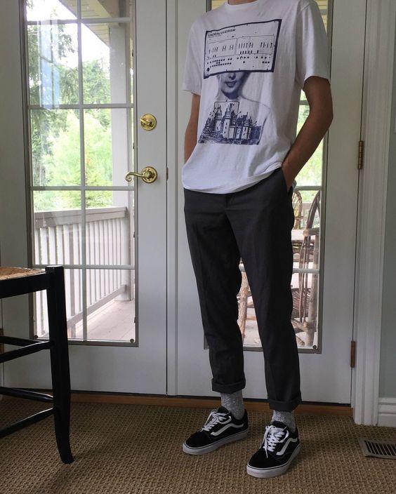 a printed tee, pants, black Vans