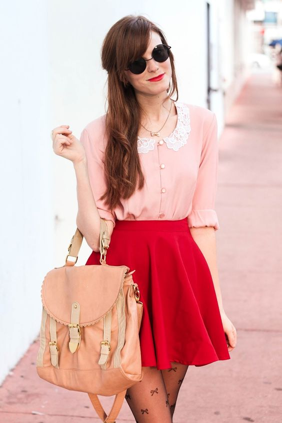 a red mini, a vintage-inspired blush shirt with a lace collar, a blush handbag