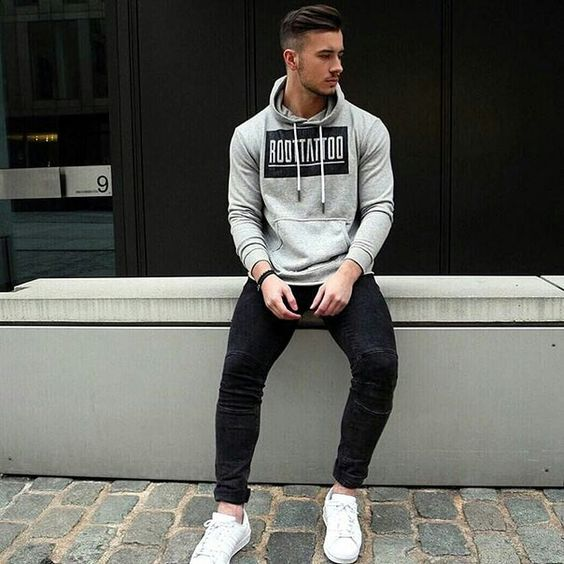 black jeans, white sneakers and a grey sweatshirt