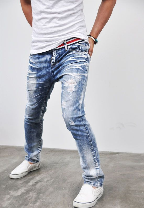 distressed blue jeans, a white tee and white Converse