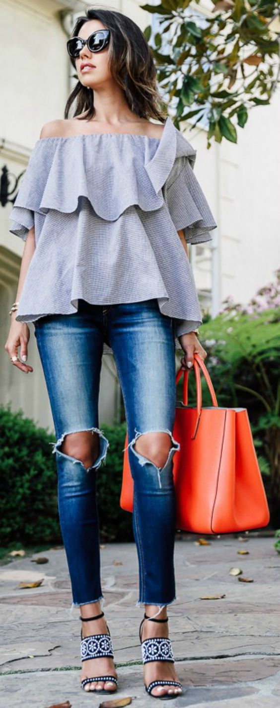 layered grey off the shoulder top, ripped jeans, a coral tote and whimsy heels