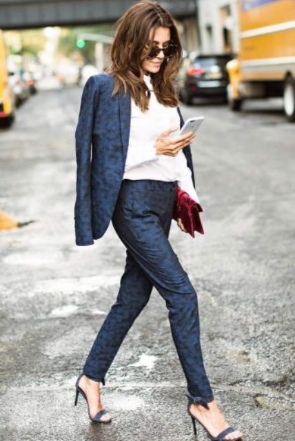 printed navy pantsuit, navy heels and a white shirt