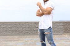04 blue ripped jeans, a white shirt, ocher shoes