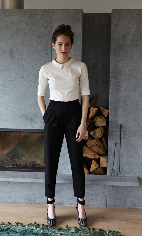 a casual ivory shirt, high waist black pants and heels