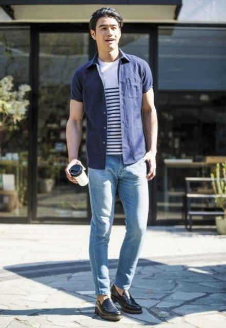 blue jeans, moccasins, a striped tee and a navy shirt
