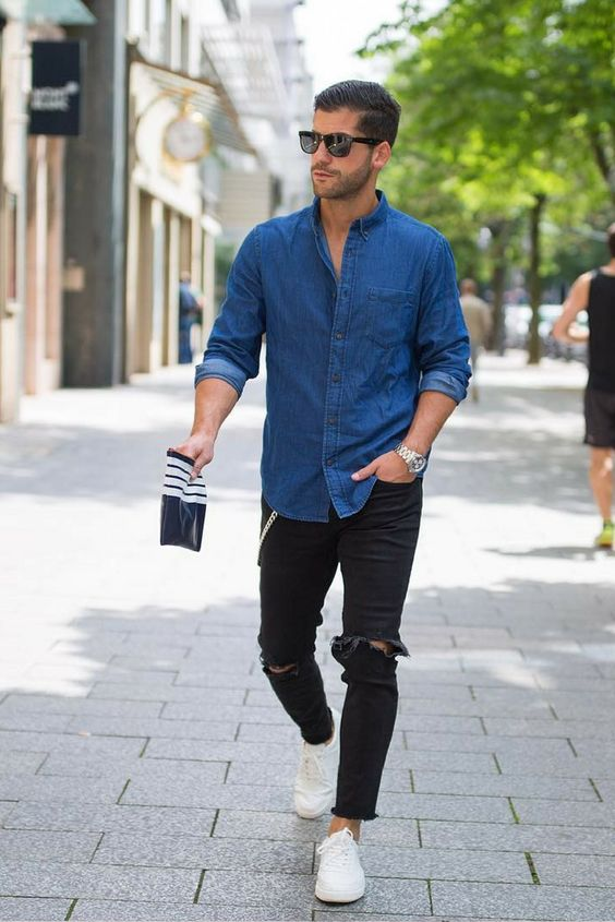 black ripped denim, a chambray shirt and white sneakers