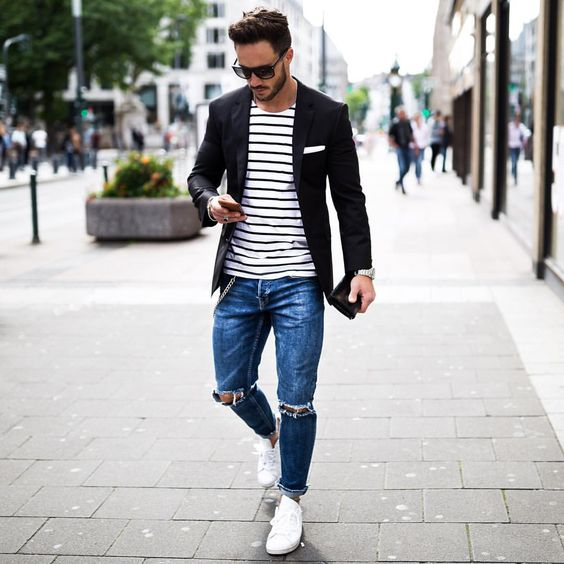 blue ripped jeans, a striped tee, a black jacket and white sneakers