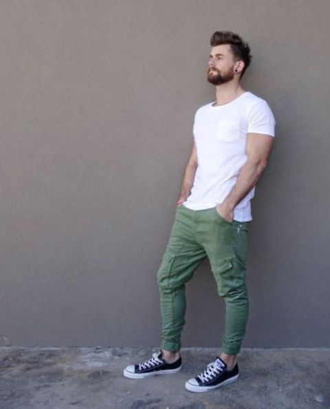 green sport pants, a white tee and black Converse