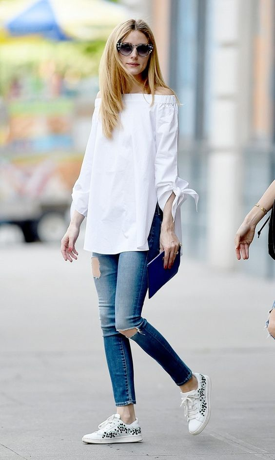 ripped jeans, a white off the shoulder top, white printed sneakers by Olivia Palermo