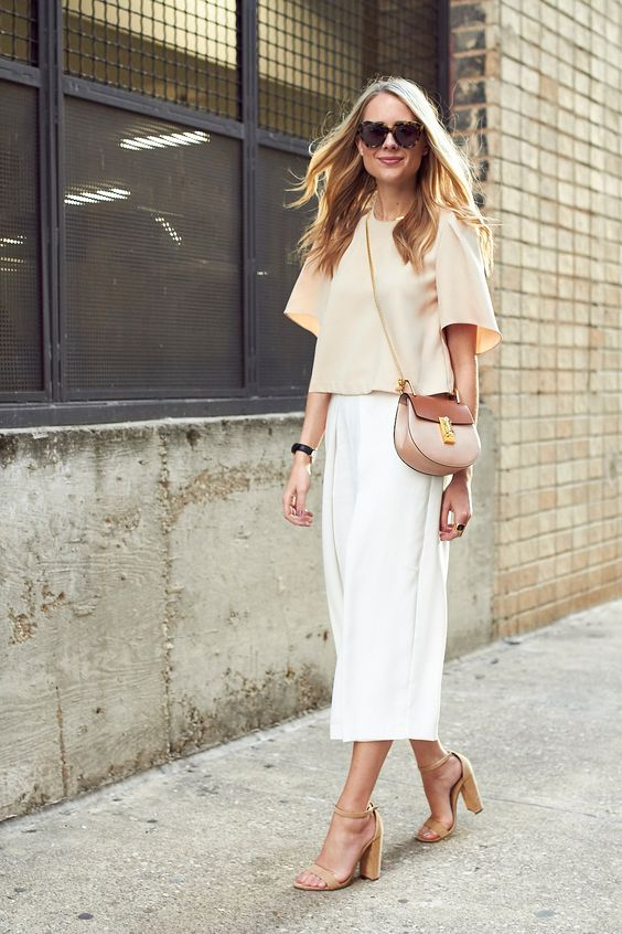 white midi, a beige top with shirt sleeves and beige comfy heels