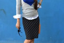 07 a polka dot skirt, a graphic sweater over a button up