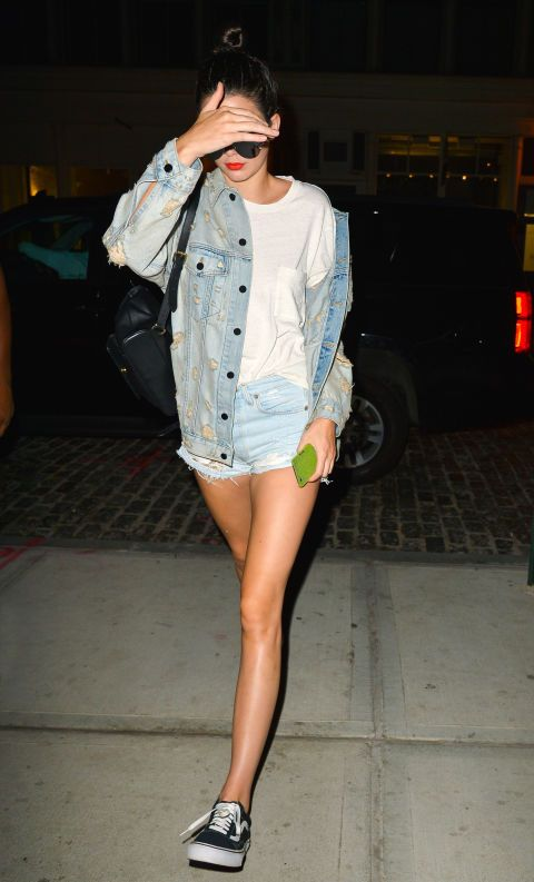 denim jacket and shorts, a white tee and black Vans