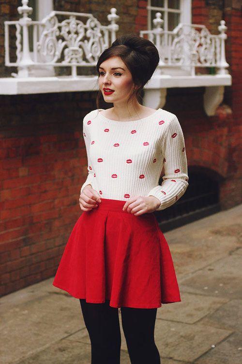 red mini, a kiss printed sweatshirt and black tights