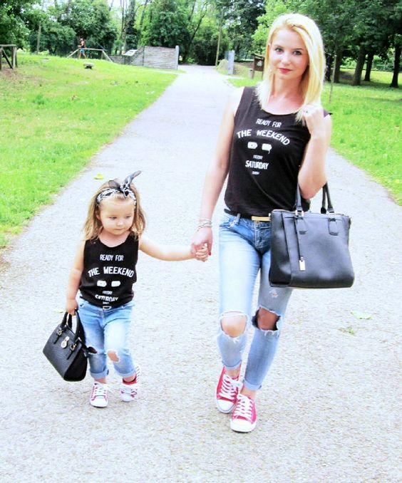 ripped jeans, black printed tops, red Converse and black totes