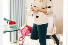 08 emerald velvet pants, a blush sweater with a black heart print and flats