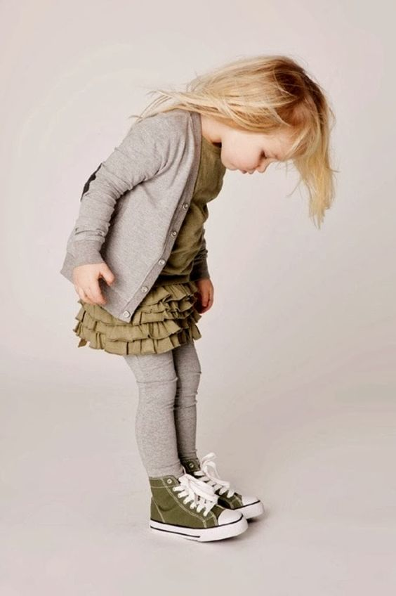 an army green dress with a ruffled skirt, a greay cardigan and leggins, army grey sneakers