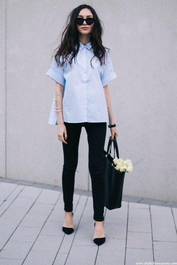 black jeans and heels, a light blue short sleeve shirt