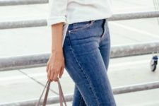 09 blue jeans, navy Converse, a white shirt and a blush bag
