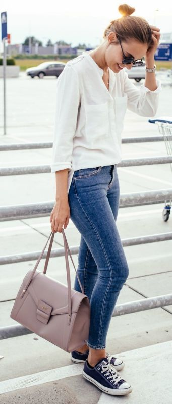 blue jeans, navy Converse, a white shirt and a blush bag