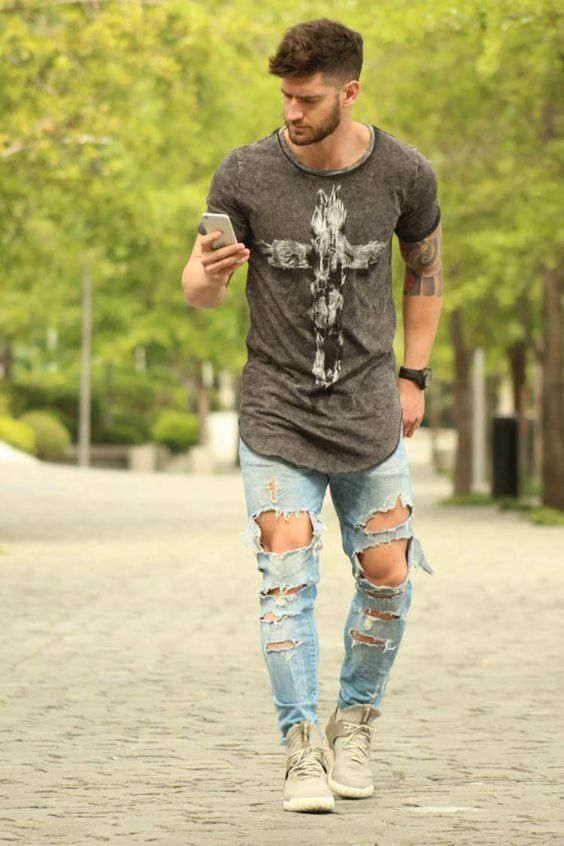 destroyed denim, a cool printed t-shirt and grey sneakers