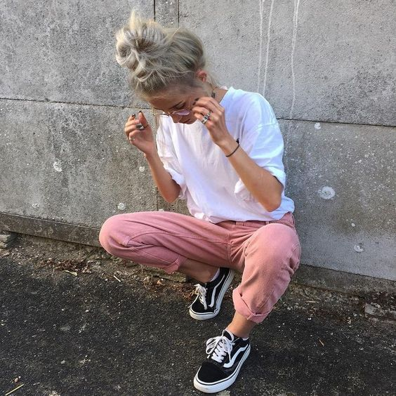 pink jeans, a white tee and black Vans