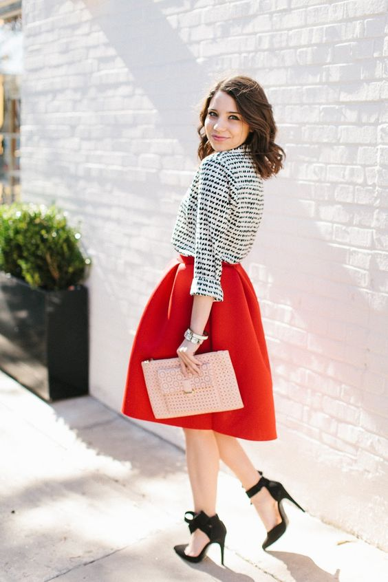 printed monochrome shirt, a red midi skirt and ankle bow heels
