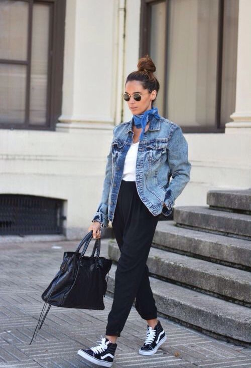 black pants, a white top, a denim jacket and black Vans
