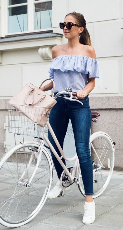 blue skinnies, a blue striped off the shoulder top and white sneakers