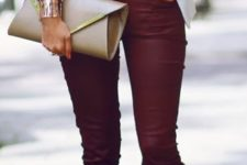 10 burgundy pants, Valentino heels, a red heart-printed shirt and a white jacket