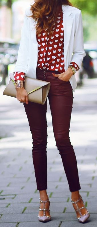 burgundy pants, Valentino heels, a red heart-printed shirt and a white jacket