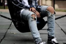 10 distressed jeans, black Vans, a white tee and a plaid shirt