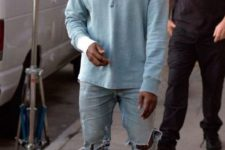 11 Kanye West rocking ripped blue denim, ocher moccasins and a light blue long-sleeve
